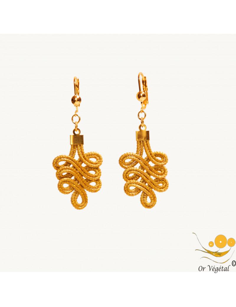 Boucles d'oreille en or végétal cerclés en forme d'arabesque