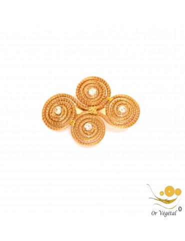 Broche  en or végétal cerclé en forme de croix en spirales & strass