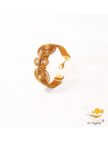 Bracelet en or végétal cerclé avec  forme double spirale en croix