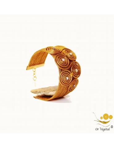 Bracelet en or végétal cerclés avec une forme de double triskel