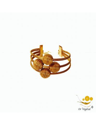 Bracelet en or végétal cerclé 6 lignes contenant 4 grandes sphères en croix