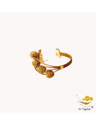 Bracelet en or végétal cerclé 4 lignes avec 4 sphères en escalier