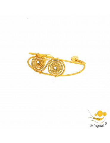 Bracelet en or vegetal double spirale allongée et strass au centre