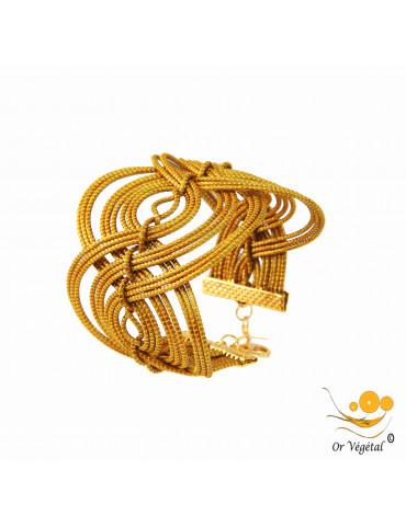 Bracelet en or végétal cerclé et entrelacé en forme de vague