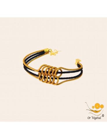 Bracelet en or végétal cerclé et entrelacé en boucle avec macramé noir