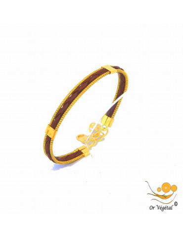 Bracelet en or végétal cerclé avec un tressage en cuir marron