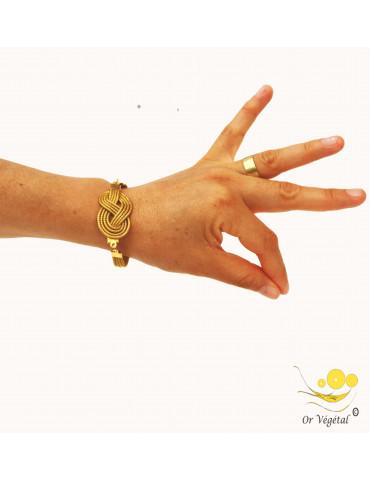 Bracelet en or végétal articulé cerclé en forme de nœud de huit dessus