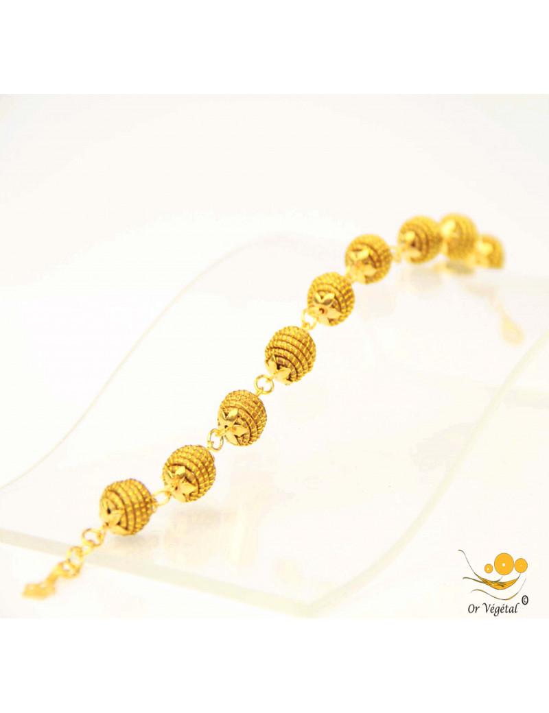 Bracelet en or végétal cerclé en forme d'une chaîne sphères
