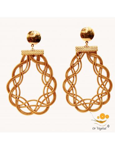 Boucle d'oreille en or végétal ceclé en forme d'arabesques entrelacées